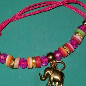 Red Bracelet With Gold color Elephant